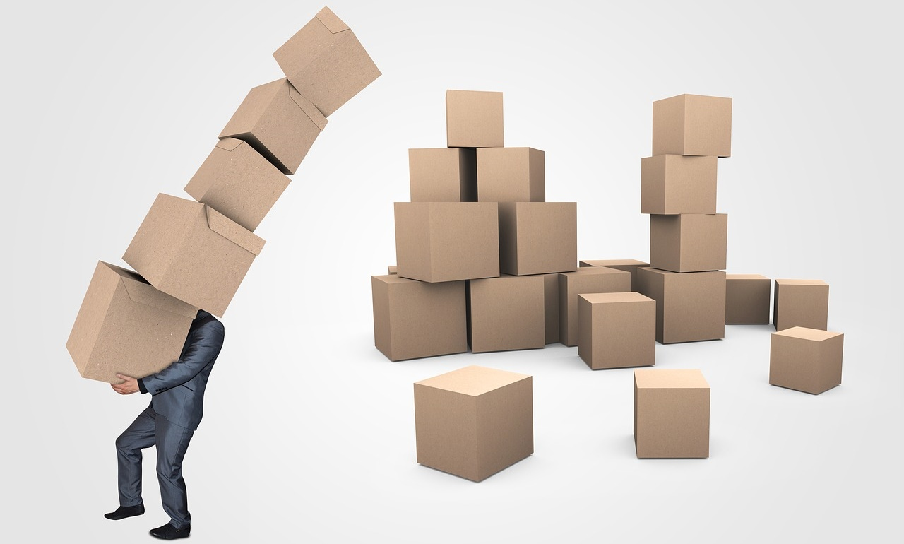 Businessman with Toppling Boxes