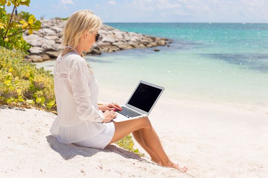 Businesswoman Working on a Beach