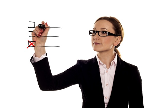 Businesswoman Checking Off Item on a Checklist