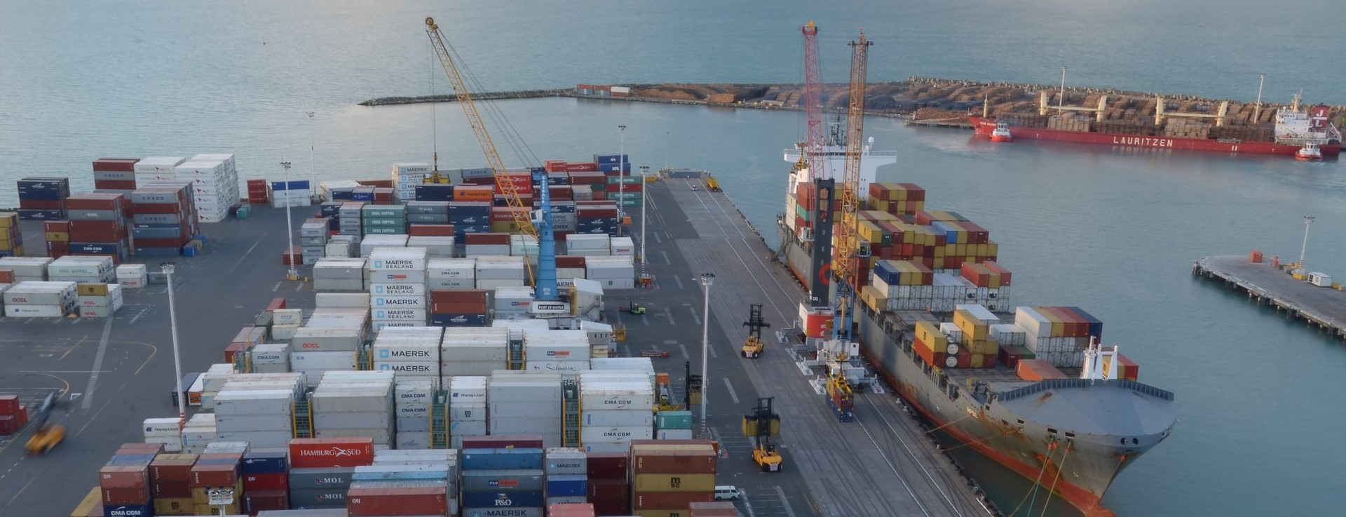 Ship docked to receive shipping containers