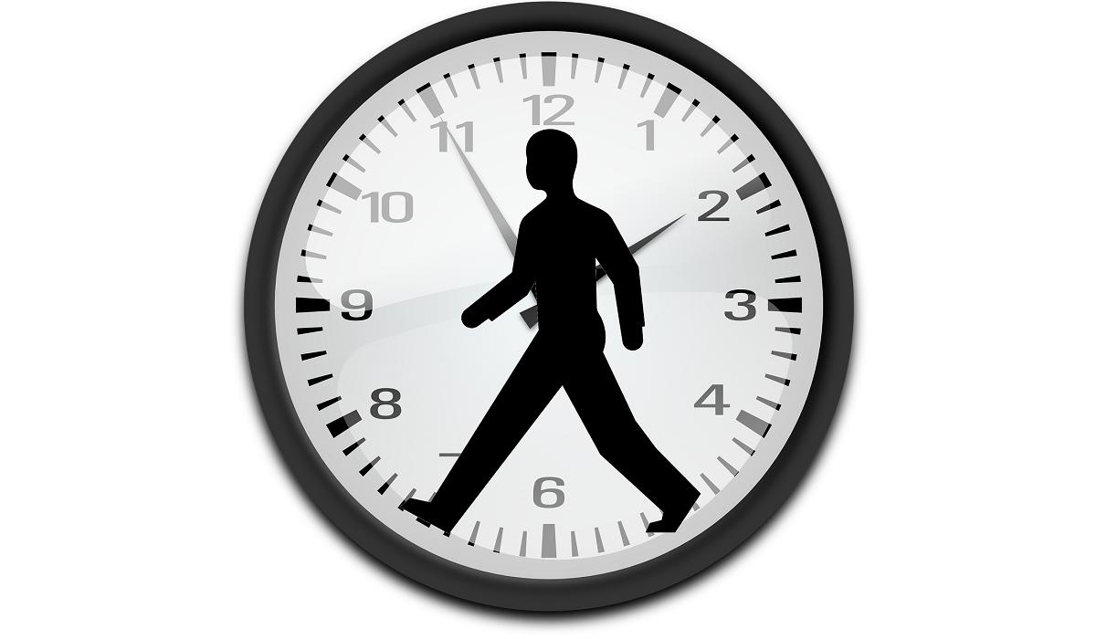 Man Walking Inside Clock
