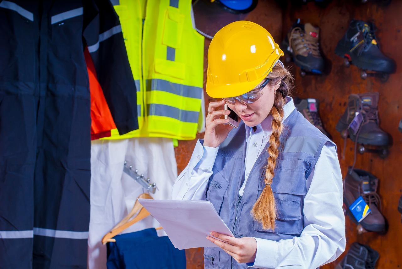 Woman in warehouse making phone call