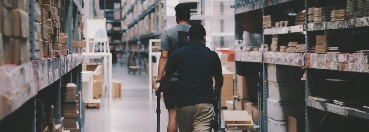 Men on a trolley in warehouse