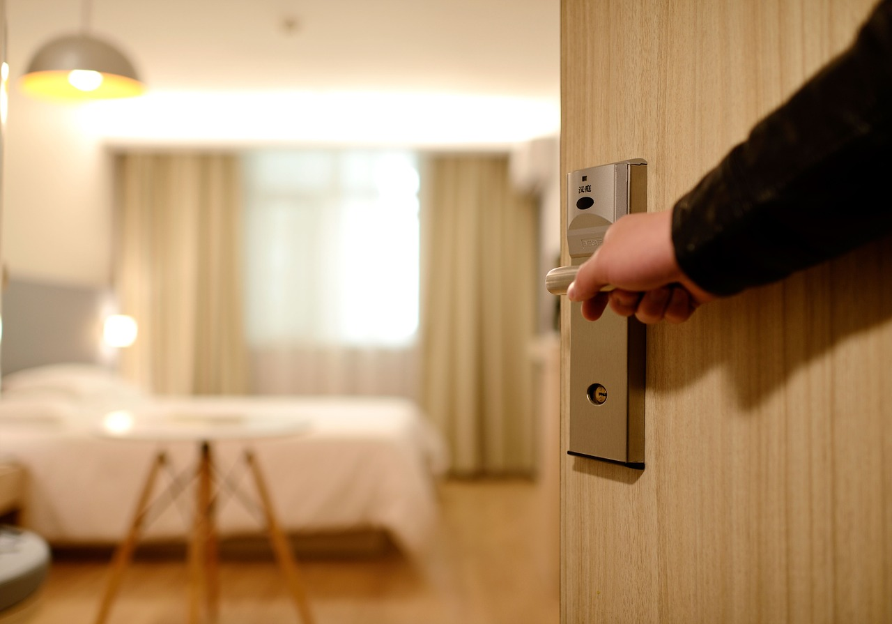 Opening the Door to a Hotel Room