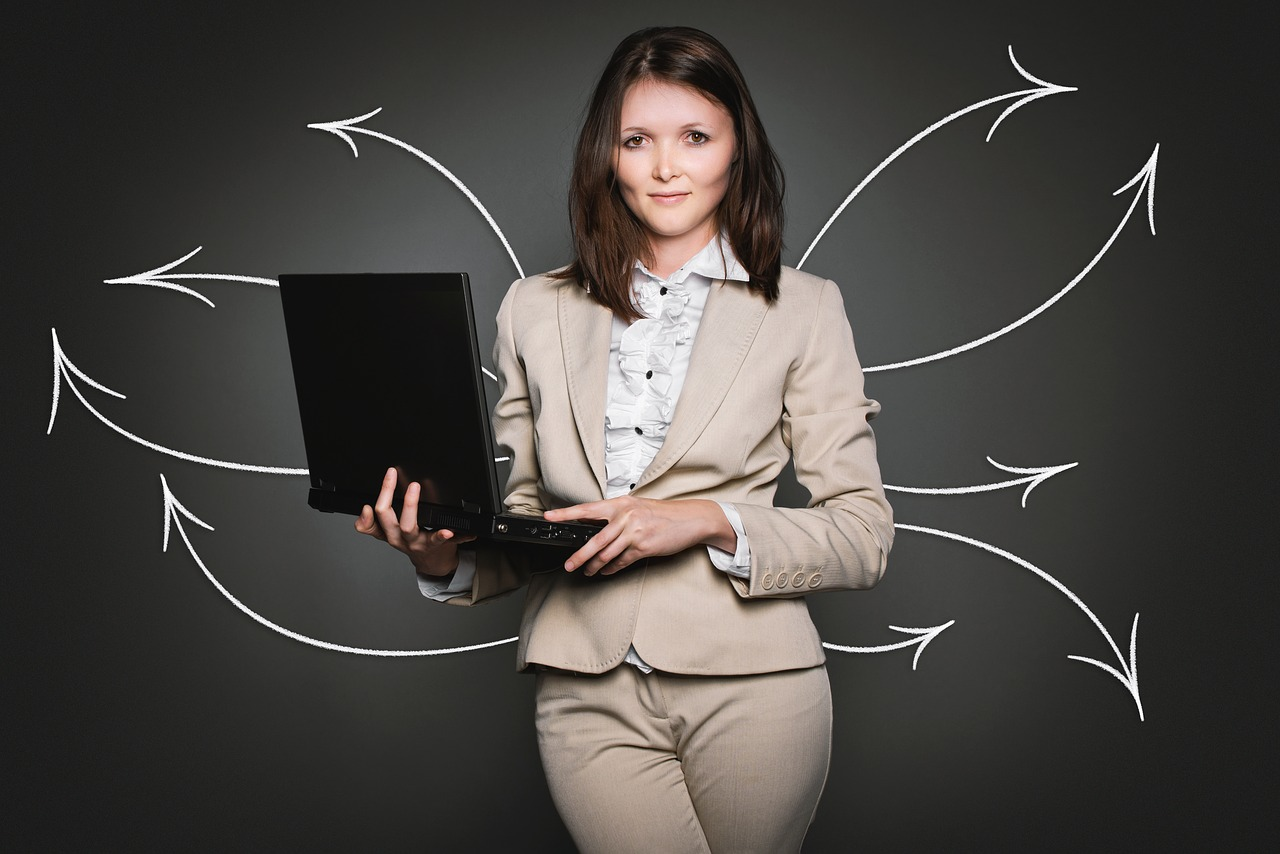 Businesswoman Searching with Laptop