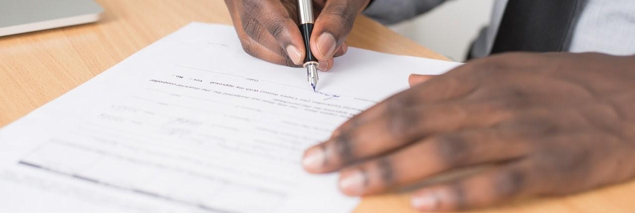 Man signing document