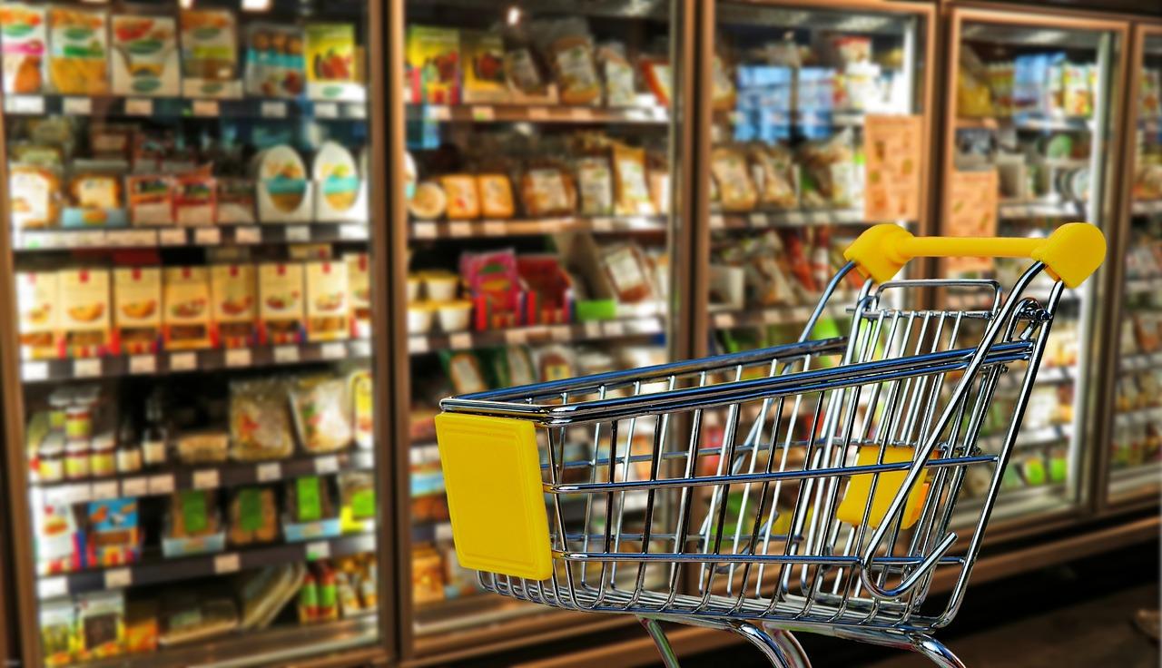 Stocked shelves and shopping cart