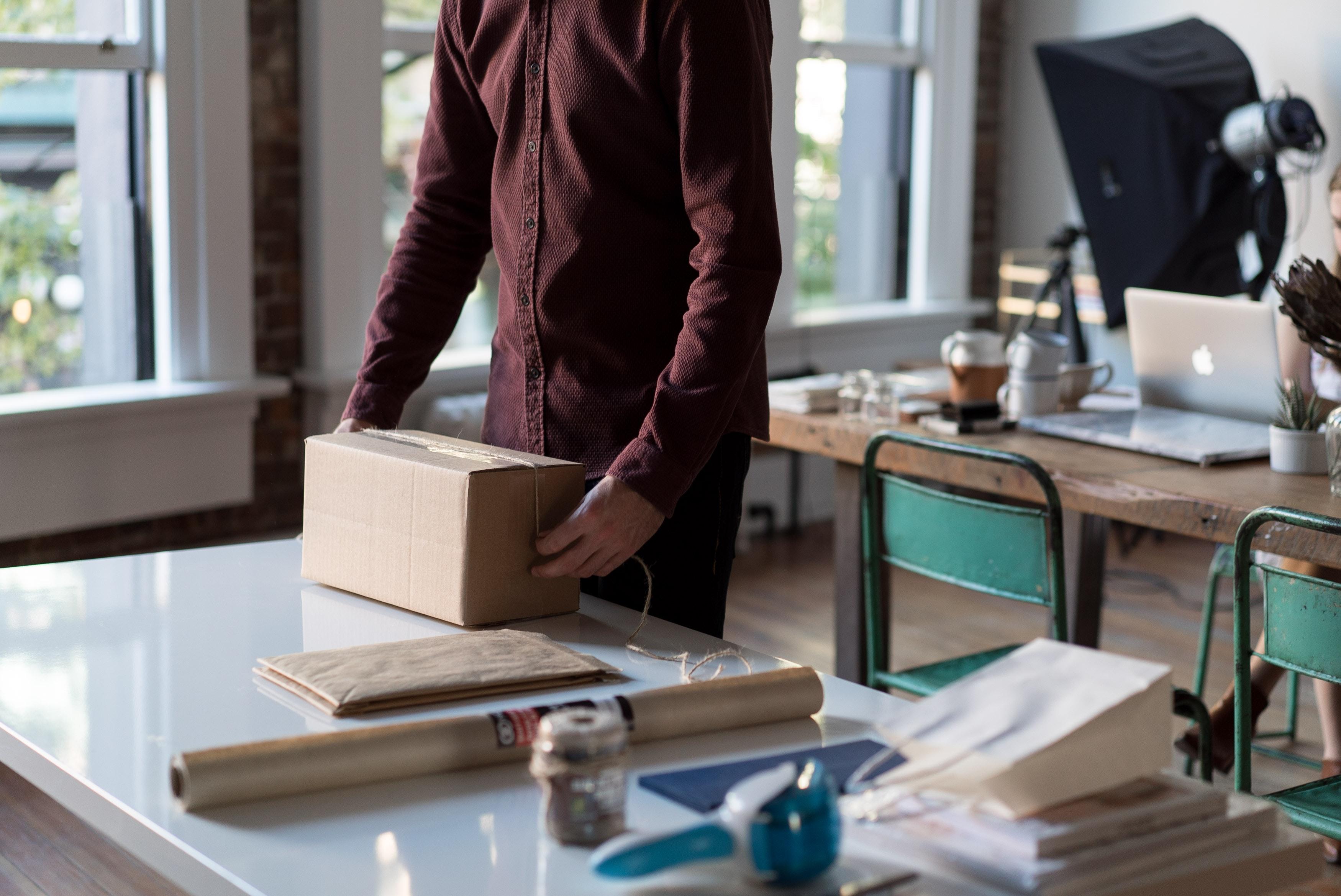 Man preparing box for shipment