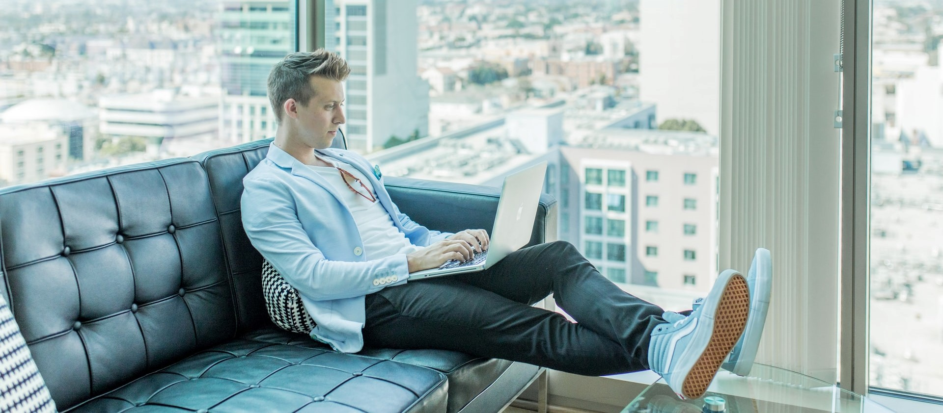 Man using a laptop in couch