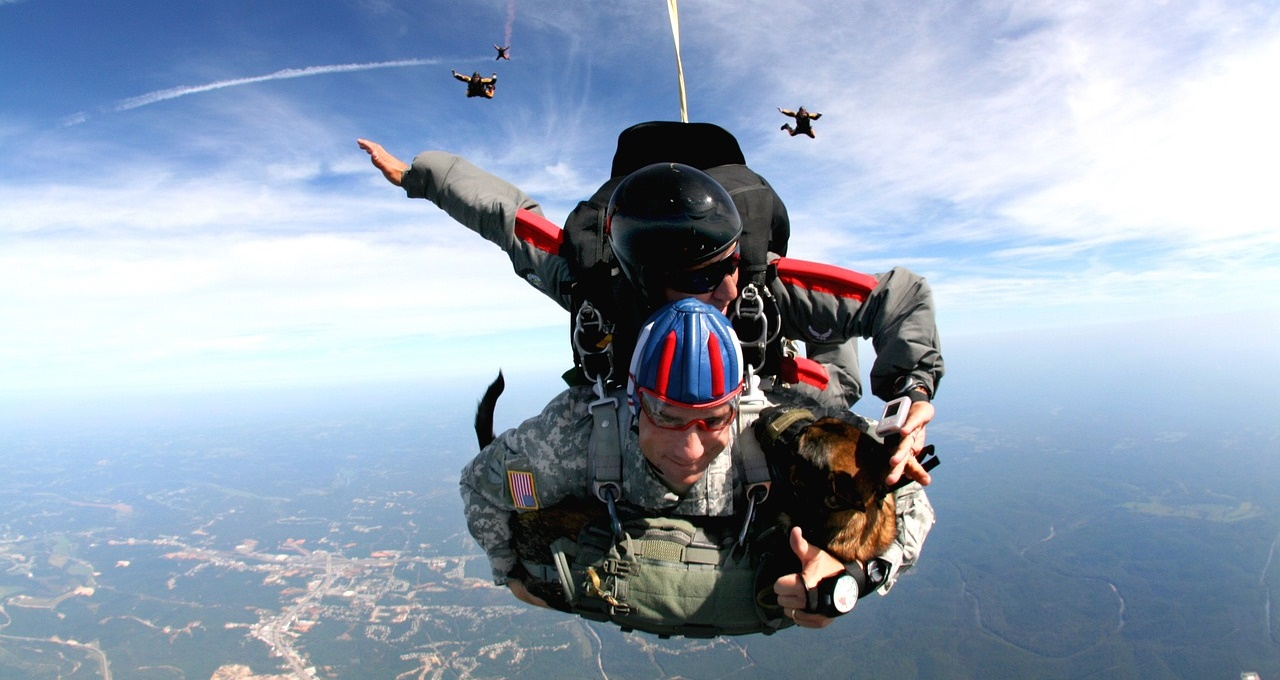 Tandem Skydivers with Dog