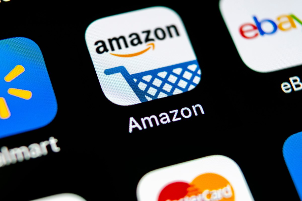 Walmart, Amazon and eBay Mobile Apps on a Phone Screen
