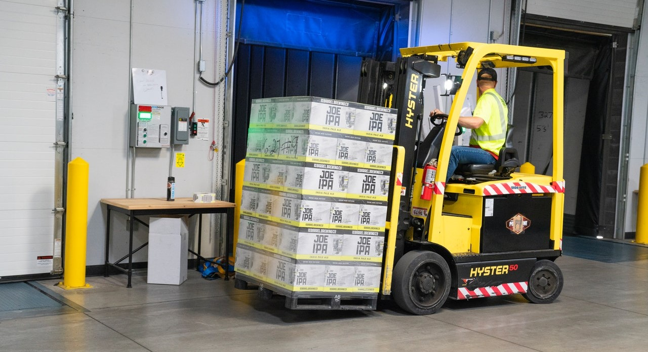 Man driving a forklift in a warehouse